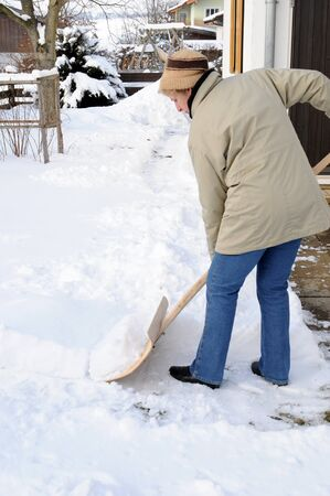 Woman is shovelling snow Stock Photo - 10310136
