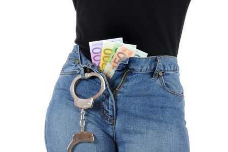Young woman with handcuffs and Euro-Money Stock Photo - 10310137