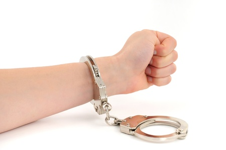 Hand of a young woman in handcuffs photo