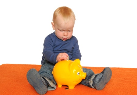 One year old boy with yellow piggy bank Imagens - 10314906