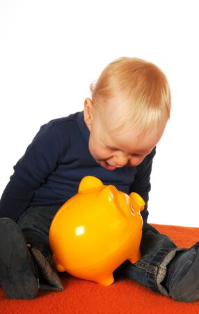 One year old boy with yellow piggy bank photo