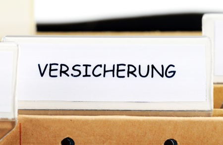 Hanging file folder for insurance (= Versicherung) informations photo