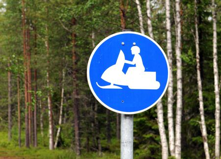 Snowmobile track in the Finnish woods Stock Photo - 10389225