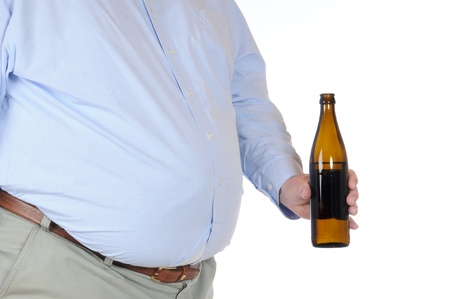 Fat man with a bottle of beer isolated on white Stock Photo