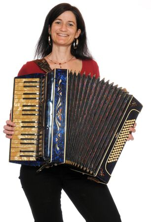 dark haired woman: Dark haired woman with accordion in front of a white background