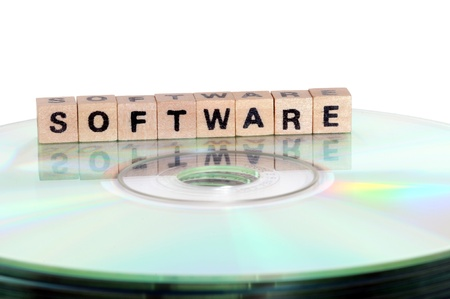 The word Software written in wooden letters standing on a computer-CD Stock Photo - 11576625