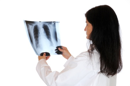 roentgenogram: A young doctor is looking at the X-ray photograph Stock Photo