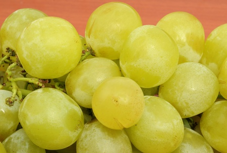 Fresh grape in front of a wooden background