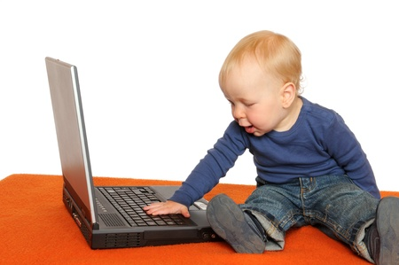 One year old boy with laptop