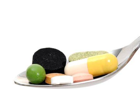 Medicine on a spoon in a studio shot photo