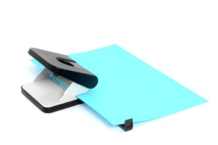 Hole puncher with paper in front of a white background Stock Photo - 12471090
