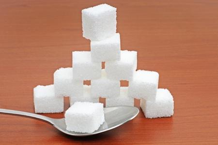 White sugar lumps in a studio shot Stock Photo
