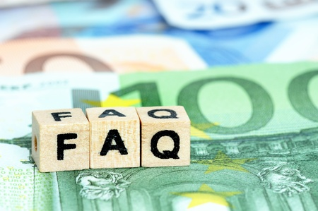 Letters FAQ in wooden letters on Euro currency photo