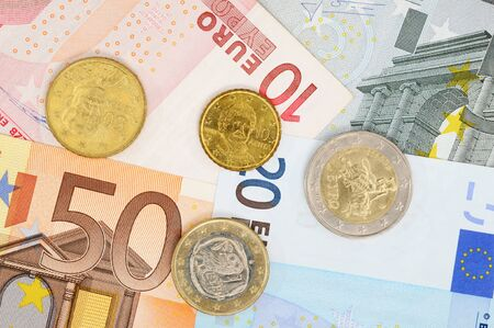 greek currency: Greek Euro coin and banknotes as symbol for the fincancial problems of that country