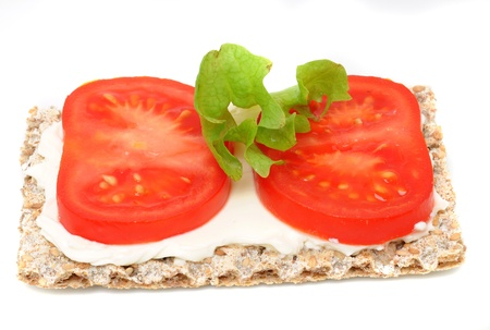 Crispbread with cream cheese, tomato and cucumber photo