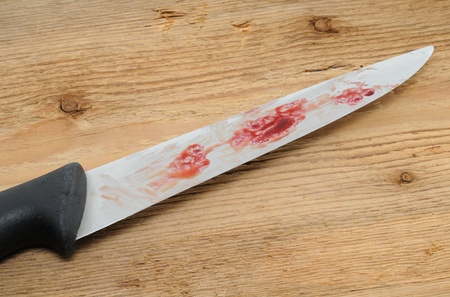 criminal act: Bloody knife as symbol for a criminal act