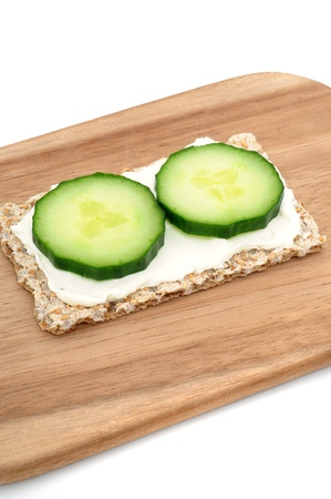 Crispbread with cream cheese and cucumber photo
