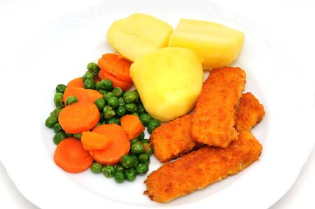 carots: Fish fingers in a frying pan Stock Photo