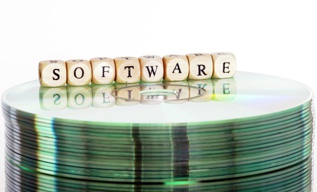 cd rw: The word Software written in wooden letters standing on a computer-CD