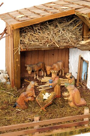 nativity scene: Old handmade nativity scene in front of a white background