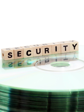 sicherheit: The word security written in wooden letters standing on a computer-CD Stock Photo