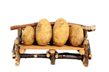 Fresh harvested potatoes on a seating bank as symbol for couch potatoes photo
