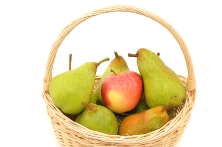 One apple and several pears in a basket in front of a white studio background photo