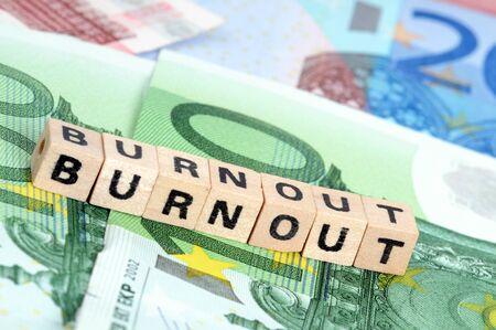 The word burnout on Euro-currency with selective focus photo