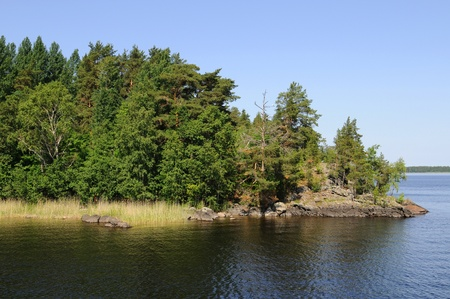 At the lakes around Savonlinna in Finland there are many small islands photo