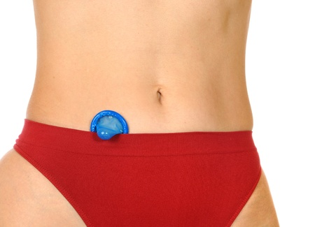 Woman in a red thong shows a blue condom photo