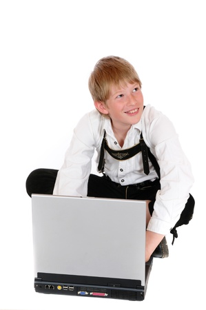 Noy with laptop in front of a white background photo