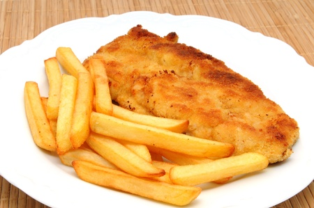 breaded: Schnitzel with french fries Stock Photo