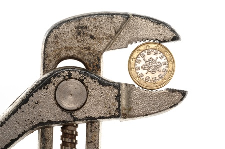 Portugal Euro coin in rusty pliers as symbol for the fincancial problems of that country photo