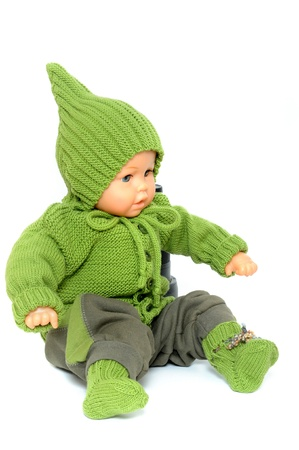 Handknitted baby dress in front of a white background photo