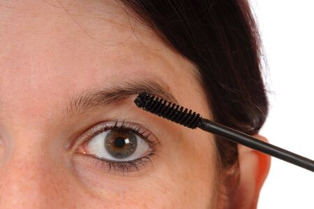 Young woman with mascara photo