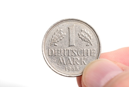 deutschemarks: One Deutschmark, meanwhile not valid any more, with selective focus Stock Photo