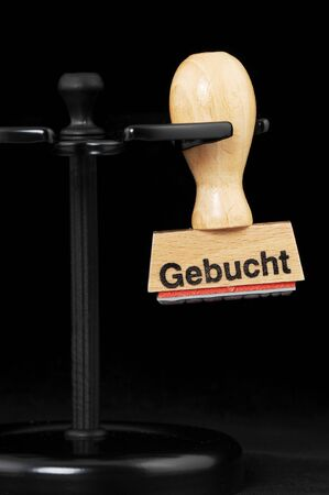 booked: Ruber stamp  gebucht   = booked  in an office