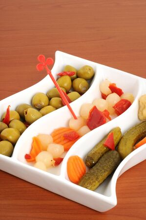 Cup with mixed pickles as appetizer photo