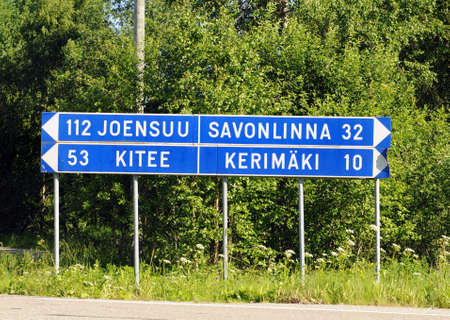 Blue direction sign in Finland Stock Photo - 14416719