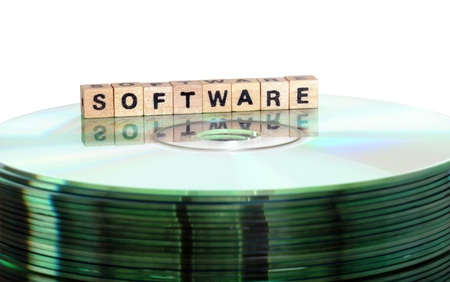 schriftzug: The word Software written in wooden letters standing on a computer-CD