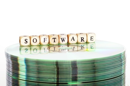 The word Software written in wooden letters standing on a computer-CD Stock Photo - 14453002