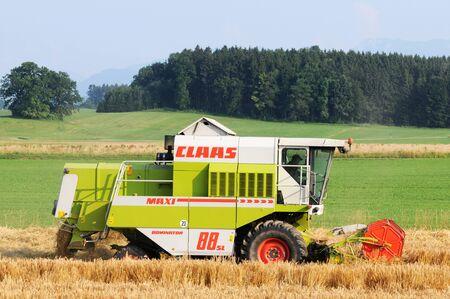 shredder machine: Combine harvesting corn in Bavaria