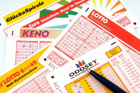 Lottery tickets and pen  Editorial