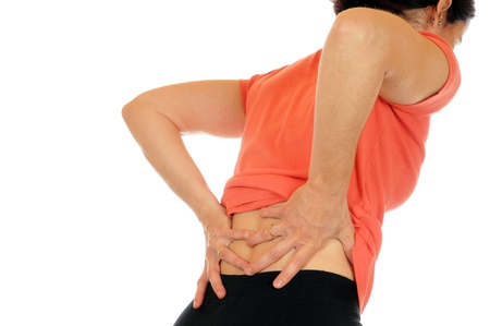 hand on hip: Young slim female has backache Stock Photo