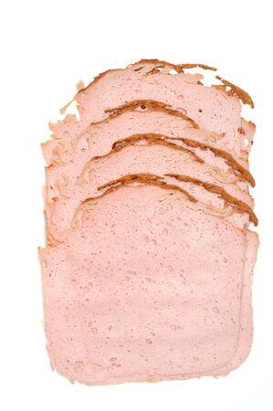 leberkaese: Some slices of Bavarian Leberkaese on white background