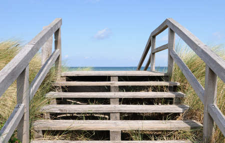 Footbridge over a dune at the beach of Heiligenhafen in Northern Germany photo