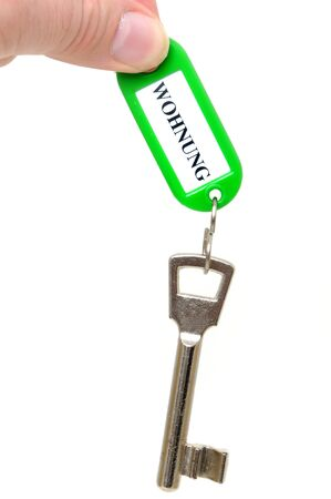 key fob: Key fob qwith WOHNUNG = flat in a studio shot