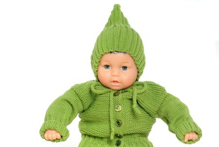 babycare: Handknitted baby dress in front of a white background, own knitting, no-name doll, no copyright Stock Photo