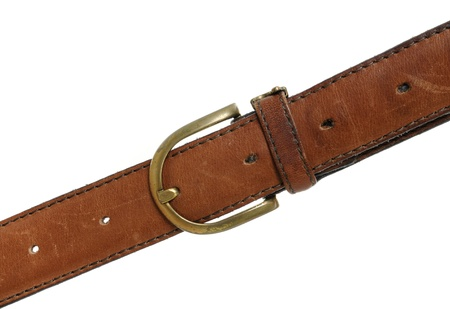 Leather belt in front of a white background Stock Photo