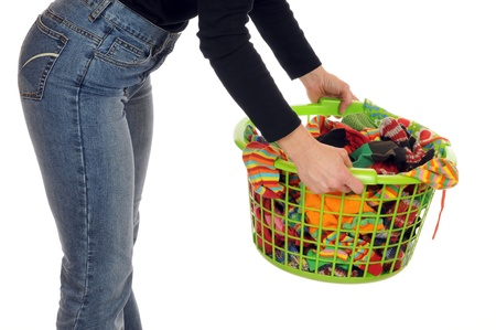 dry cleaned: Young woman with a laundry basket full of socks